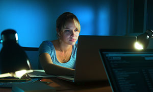 photo of woman concentrating on work