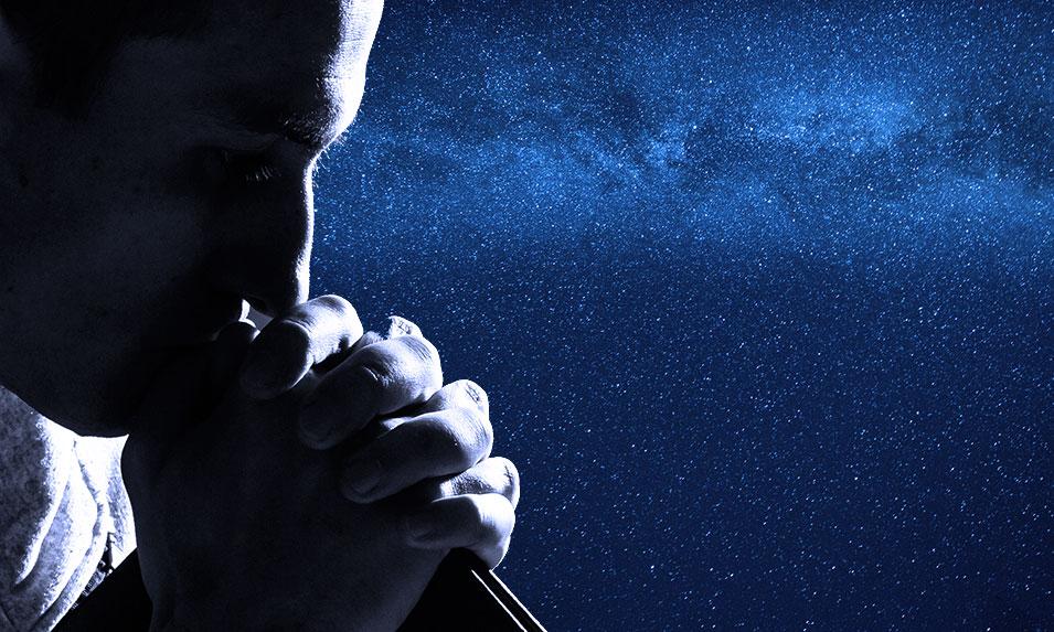 man praying at night